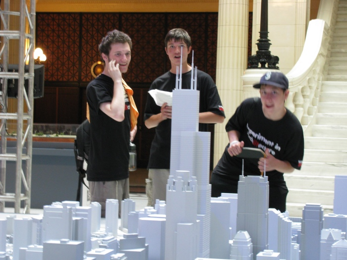 "Jacob, Chris, and Peter looking at 1"" = 100' scale model of the City of Chicago."