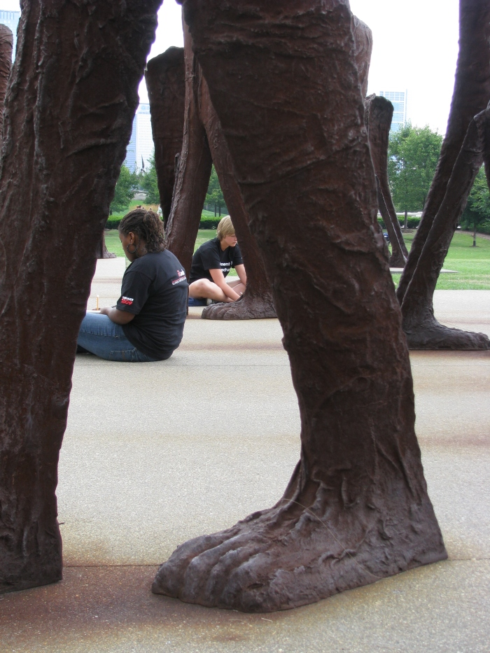 "Jasmine and Lefie sketching at ""Agora"" statue by Magdalena Abakanowicz"